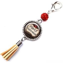 Bijoux de sac, porte clés, pompon, bijoux cabochon, une maîtresse qui déchire