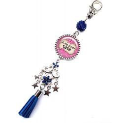 Bijoux de sac, porte clés, pompon, bijoux cabochon, une tata qui déchire
