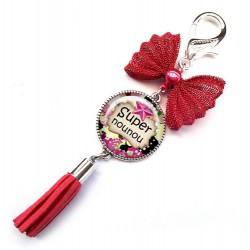 Bijoux de sac, porte clés, pompon, bijoux cabochon, une nounou formidable